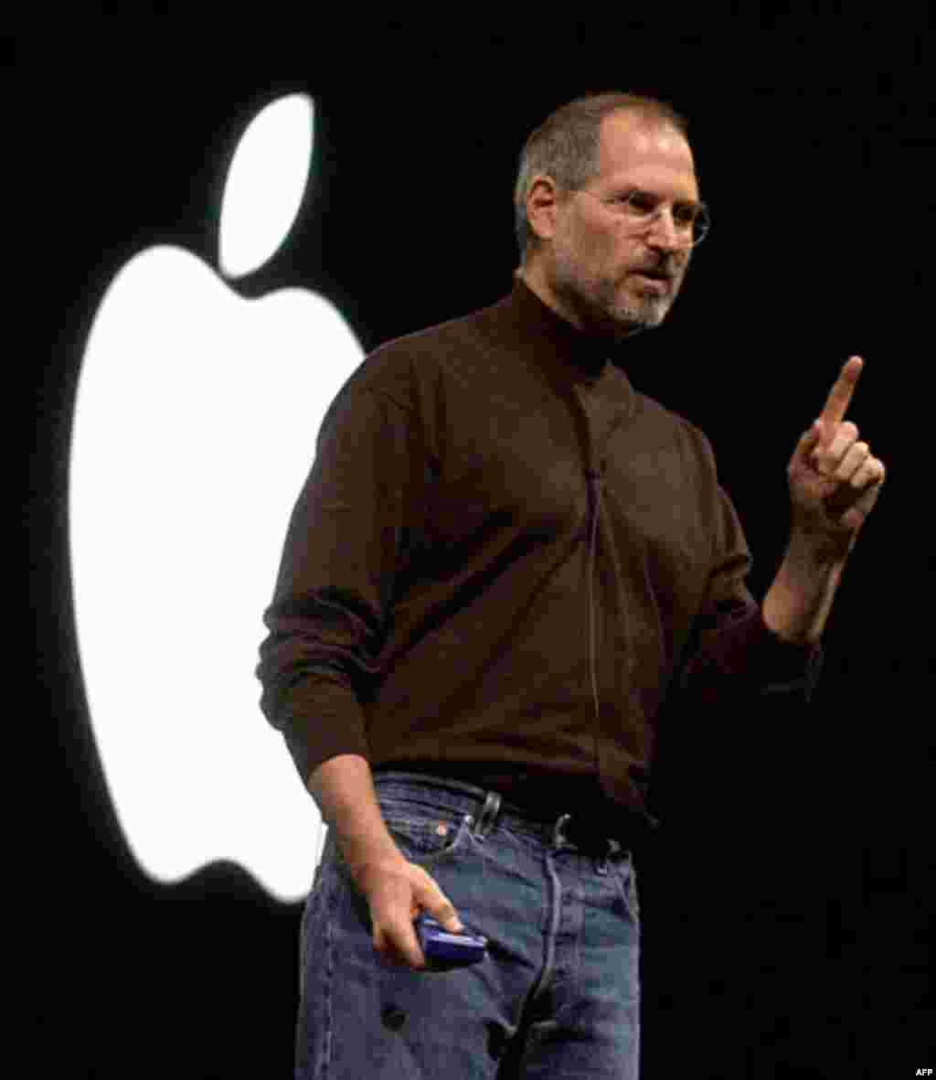 Apple Computer, Inc., CEO Steve Jobs gestures Thursday, Oct. 16. 2003, during a media presentation in San Francisco. In a move to reach the broader market of Microsoft-platform users, Jobs unveiled a fully Windows-compatible Apple iTunes Music Store, whic