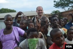 Director of Jacaranda School, Luc Deschamps with students (VOA/L. Masina)