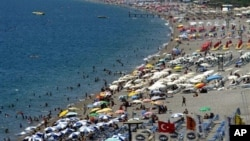 FILE - Local and foreign tourists fill Konyaalti beach in Antalya, southern Turkey, Aug. 29, 2006. The tourism industry has taken a big hit this year because of security threats.