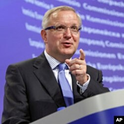 European Commissioner for Economic and Monetary Affairs Olli Rehn speaks during a media conference at EU headquarters in Brussels on Aug. 5, 2011