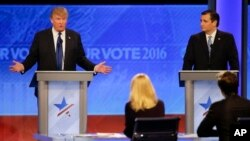 Republican presidential candidate, businessman Donald Trump answers a question as Republican presidential candidate, Senator Ted Cruz of Texas listens during a Republican presidential primary debate on Feb. 6. Candidates are talking often about their religious beliefs. (AP Photo/David Goldman)