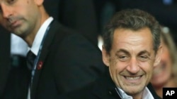 France's former President Nicolas Sarkozy at Parc des Princes stadium, in Paris, France, Sept. 22, 2013.