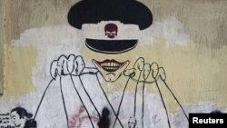 Grafiti yang menyindir militer di Mesir. (Photo: Reuters)