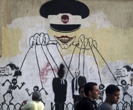 This graffiti near Cairo's Tahrir Square depicts the ruling military council as controlling the presidential elections. (Reuters)