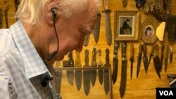 Forrest Fenn in his vault assembling Sitting Bull's original pipe. (Photo: P. Poulou / VOA )