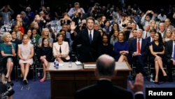 U.S. Supreme Court nominee Judge Brett Kavanaugh is sworn in by committee Chairman Chuck Grassley to testify during his U.S. Senate Judiciary Committee confirmation hearing on Capitol Hill in Washington, U.S.