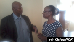 Health Portfolio Committee chair Dr. Peter Mataruse talks to Zimbabwe Medical Association President Dr. Agnes Mahomva after a 2016 budget consultation meeting at parliament building.