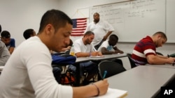 In this April 13, 2010 photo, Professor Derron Bowen teaches high school math to college students in the Broward County Community College math building in Davie, Fla. (AP Photo/J Pat Carter)