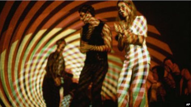 """A young couple dance under a psychedelic light show at """"The Electric Circus"""" nightclub in the East Village in New York, in 1967. The """"Electric Circus"""" embodied the wild and creative side of 1960's club culture."""