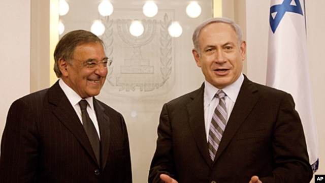 U.S. Defense Secretary Leon Panetta, left, smiles as Israel's Prime Minister Benjamin Netanyahu speaks, in the Prime's Minister office in Jerusalem, Oct. 3, 2011.