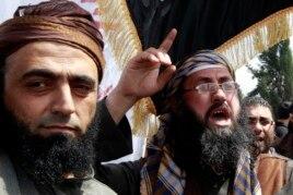FILE - Members of Jordan's Salafi jihadi shout slogans during a demonstration against prolonged detention of the group's leaders in Amman, Jordan, April 9, 2013.