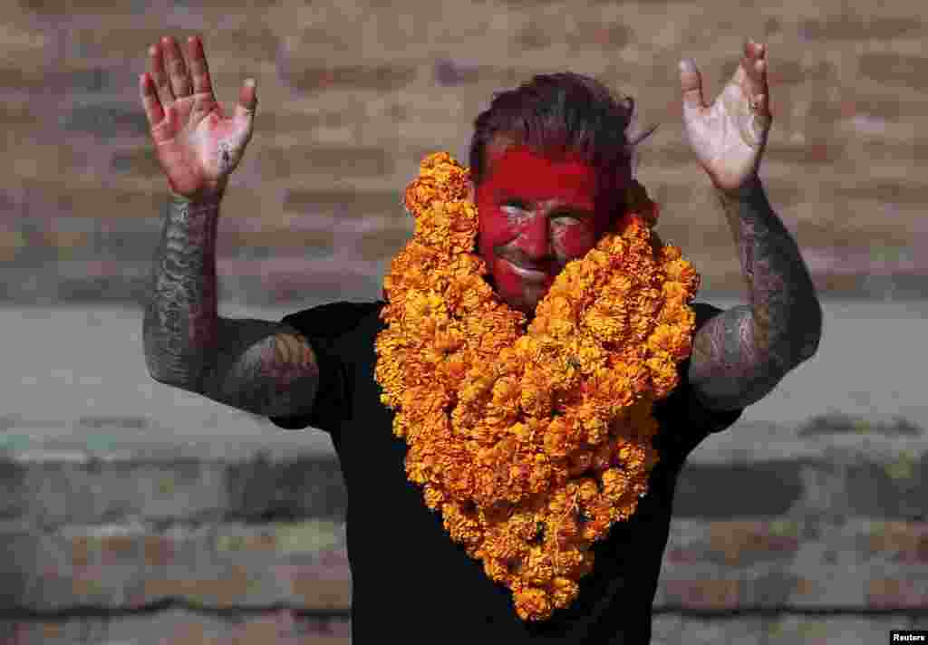 David Beckham waves toward his fans after playing a charity match to collect funds for the United Nations Children's Fund (UNICEF) in the ancient city of Bhaktapur, Nepal.