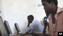 Internet users at a cyber cafe in Somalia