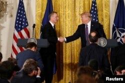 U.S. President Donald Trump, right, and NATO Secretary General Jens Stoltenberg