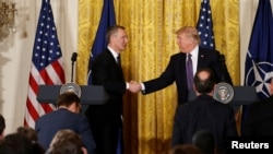 U.S. President Donald Trump (R) and NATO Secretary General Jens Stoltenberg