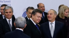 Ukrainian President Viktor Yanukovych, center, arrives on the podium for a group photo at an Eastern Partnership Summit in Vilnius on Friday, Nov. 29, 2013.