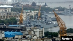 FILE - An elevated view shows the Indian Navy ships docked at the naval dockyard in Mumbai.