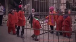 Syrian Children Locked in Cage in Protest Echoing IS Video