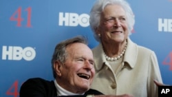 President George H.W. Bush, and his wife former first lady Barbara Bush, arrive for the premiere of HBO's new documentary on his life near the family compound in Kennebunkport, Maine, Tuesday, June 12, 2012.