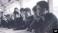 Khmer Rouge cadres at a communal hall. (Tuol Sleng Genocide Museum Archives)