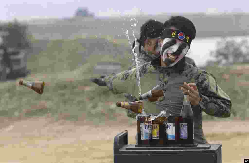 A South Korean army special forces soldier breaks bottles with his hand during the Naktong River Battle re-enactment in Waegwan.