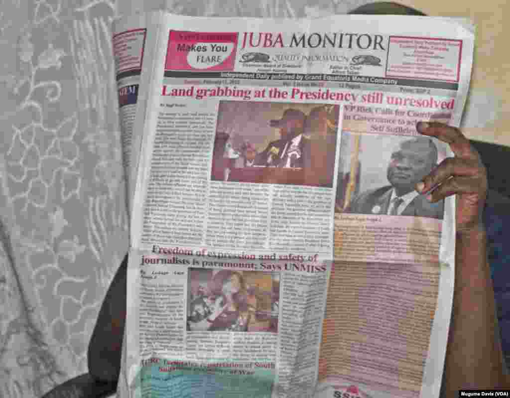 A person reads The Juba Monitor on the day the paper ran the story about the U.N. Mission in South Sudan's (UNMISS) Plan of Action on the Safety of Journalists.South Sudan has agreed to test drive the plan, which calls for defamation to be decriminalized and greater protections for journalists. (VOA/Mugume Davis)