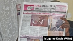 A person reads the Juba Monitor on the day the paper ran the story about the U.N. Mission in South Sudan's (UNMISS) Plan of Action on the Safety of Journalists. South Sudan has agreed to test drive the plan, which calls for defamation to be decriminalized.