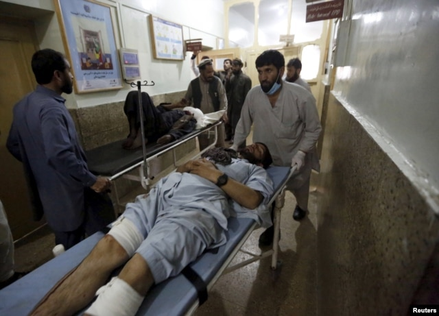 Injured men are brought in for treatment at a hospital after a suicide attack in Asadabad, capital of Kunar province, Afghanistan, Feb. 27, 2016.