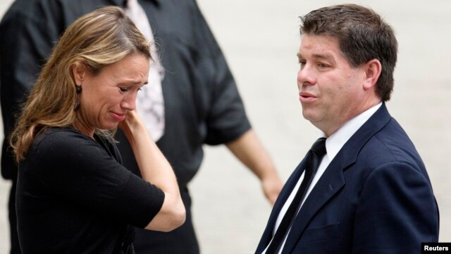 A mourner weeps outside the funeral services of James Gandolfini at the Cathedral Church of Saint John the Divine in New York, June 27, 2013.