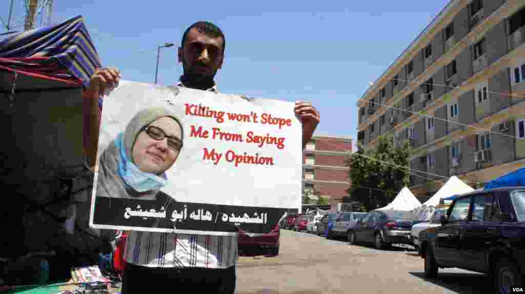 A protester vows to carry on a sit-in by Morsi supporters after deadly clashes Saturday in Cairo, July 27, 2013, (Elizabeth Arrott/VOA).