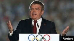 FILE - International Olympic Committee (IOC) President Thomas Bach delivers a speech during the closing ceremony of the 2014 Nanjing Youth Olympic Games in Nanjing, Jiangsu province, August 2014.