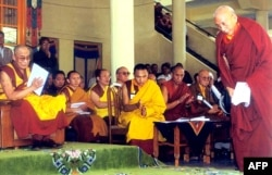 FILE - Tibetan spiritual leader Dalai Lama (L) greets Prime Minister of the Tibetan government-in-exile Samdong Rinpoche (R) during celebrations of the 360th anniversary of the creation of the Tibetan government, in Dharamsala, India, June, 5, 2002.