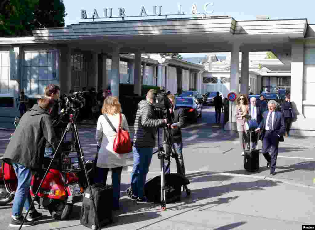 Members of the media stand outside the Baur au Lac hotel in Zurich, Switzerland, May 27, 2015.