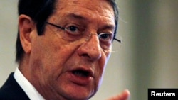 Cyprus' President Nicos Anastasiades addresses a conference of civil servants in Nicosia, March 29, 2013.