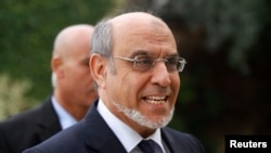 Then-Tunisian PM Hamadi Jebali arriving for a round of consultations with other political parties at the Carthage Palace in Tunis, February 15, 2013 file photo.