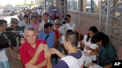 Residents line up to receive yellow fever vaccinations in Clorinda, Argentina on Feb. 20, 2008, after cases of the disease were reported near the capital, Asuncion.