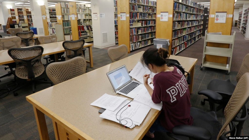 In this June 20, 2019, photo a student works in the library at Virginia Commonwealth University in Richmond, Virginia.