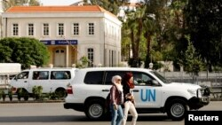 FILE - A United Nations vehicle carrying Organization for the Prohibition of Chemical Weapons (OPCW) inspectors is seen in Damascus, Syria, April 17, 2018.