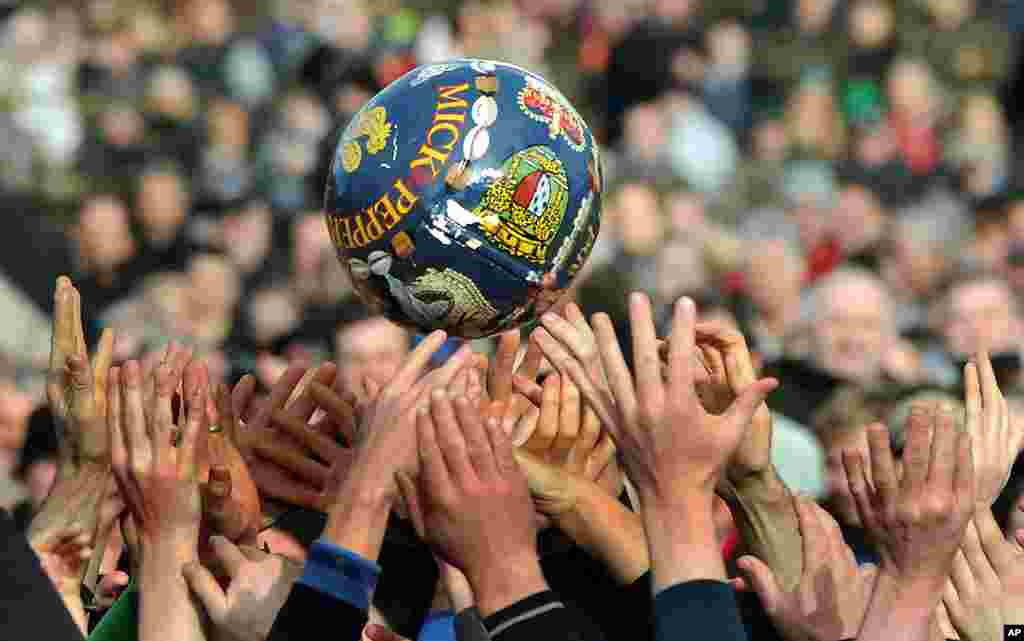 The Up'Ards and the Down'Ards fight for the ball during the first day of the Royal Shrovetide Football match in Ashbourne, Derbyshire England.