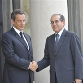France's President Nicolas Sarkozy, left, greets the head of Libya's opposition government Mahmoud Jibril at the Elysee Palace in Paris, August 24, 2011.