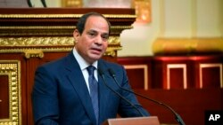 FILE - In this photo provided by Egypt's presidency media office, President Abdel-Fattah el-Sissi speaks after being sworn in for a second four-year term on June 2, 2018, in Cairo.