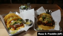 In this Friday, October 18, 2019 photo is two of the taco selections at the Earth Plant Based Cuisine restaurant in Phoenix.
