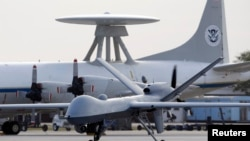 FILE - A Predator B unmanned aircraft at the Naval Air Station in Corpus Christi, Texas, Nov. 8, 2011.