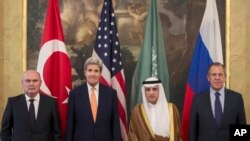 From left, Turkey's Minister of Foreign Affairs, Feridun Sinirlioglu, U.S. Secretary of State John Kerry, Saudi Arabia's Minister of Foreign Affairs Arabia Adel al-Jubeir and Russia's Foreign Minister Sergey Lavrov during a meeting in Vienna, Oct. 23,