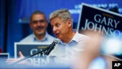 Libertarian presidential candidate Gary Johnson speaks during a rally late Monday, Oct. 3, 2016, in Parker, Colorado.