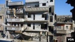 Ảnh do phe đối lập Syria phổ biến cho thấy cảnh tàn phá ở khu ngoại ô của Homs