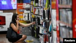 A woman shops at a Walmart Supercenter in Rogers, Arkansas, June 6, 2013.
