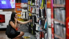 A woman shops at a Walmart Supercenter in Rogers, Arkansas, June 6, 2013.