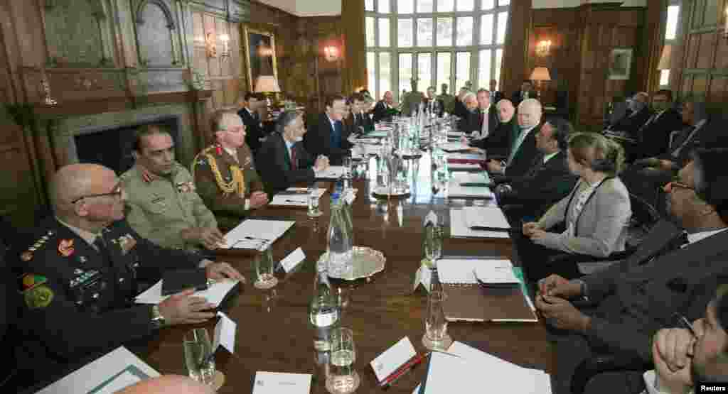 Britain's Prime Minister David Cameron chairs a meeting with Pakistan's President Asif Ali Zardari and Afghan President Hamid Karzai, at Cameron's country residence, Chequers, west of London, February 4, 2013.