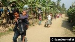 ရခိုင္ျပည္နယ္တြင္ ျဖစ္ပြားေနေသာ တိုုက္ပြဲမ်ားေၾကာင့္ တိမ္းေရွာင္ထြက္ေျပးလာခဲ့ၾကေသာ စစ္ေရွာင္မ်ား။ (မွတ္တမ္းဓာတ္ပံု - Khine Murn Chun (Citizen Journalist)